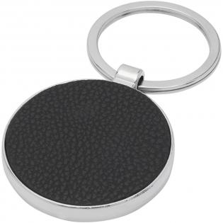 Porte-clés rond de qualité supérieure en PU avec habillage métallique en alliage de zinc, livré dans une enveloppe en papier kraft brun. Le diamètre du porte-clés est de 4cm. Adapté à la gravure, qui fera apparaître le logo en argent.