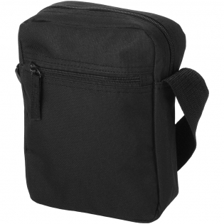 Small trendy bag with adjustable shoulder strap, zippered main compartment and zippered front pocket.