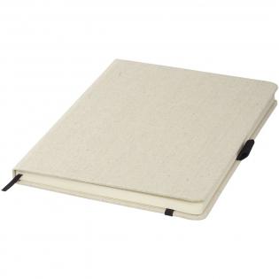 A5 formaat canvas notitieboekje met gekleurde elastieksluiting en paginalint. Een elastische penlus en 80 pagina's van 70 gram met gelinieerd papier.