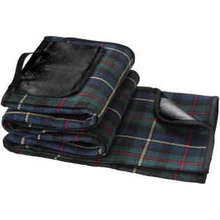 Couverture classique avec motif tartan. Le dos protège contre l'eau et la saleté. La poignée facilite le transport de cette couverture La taille de la couverture est de 145 x 130 cm.