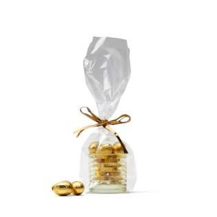 Gele theelichthouder gevuld met Belgische chocolade-eitjes