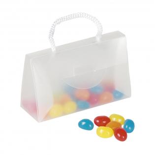 Kunststof minitasje met ca. 50 g snoepjes. Aan één zijde een transparant venster voor het insteken van een visitekaartje of reclameboodschap. Geef bij je bestelling a.u.b. de smaalkeuze aan. A chocolade B jellybeans C hartjes