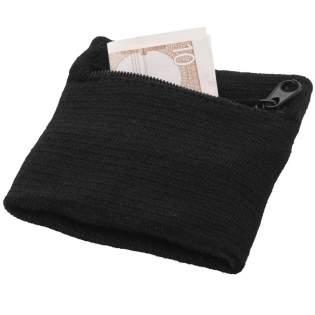 Ce poignet éponge en coton dispose d'un compartiment zippé pour ranger votre argent pendant une activité sportive, durant vos courses ou un voyage.