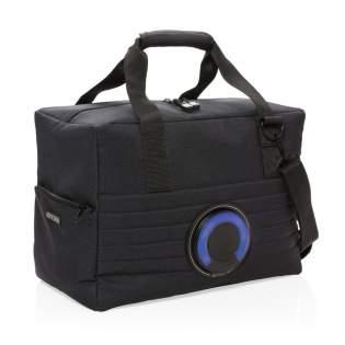 Grand sac isotherme tendance avec enceinte 3W étanche IPX5 et LED à couleur changeante. Tournez le haut-parleur pour le retirer et le placer sur votre bureau. Batterie 600 mAh pour 5 heures d'écoute. Peut contenir jusqu'à 32 canettes. Bandoulière incluse. Modèle déposé®