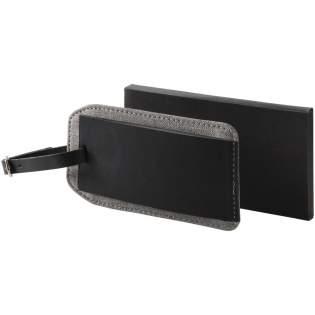 Melierter Kofferanhänger. Aufklappbare Erkennungsmarke mit einem Gurt. Die Innenseite enthält ein Identitäts-Etikett. Thermo-PU.
