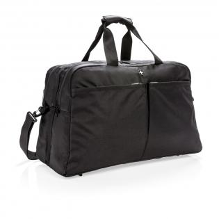"""Sac révolutionnaire 1680D et 600D combine les avantages de deux genres: la portabilité et l'organisation d'un sac de sports et le mode d'ouverture d'une valise. Fermeture à zip pour ouvrir le sac en 2 et accéder aux différents compartiments. Avec un compartiment pour ordinateur portable 15,6"""". À l'arrière, une pochette à magazines et une poche zippée facile d'accès avec protection RFID. À l'avant, 2 grandes poches zippées faciles d'accès. Sans PVC."""