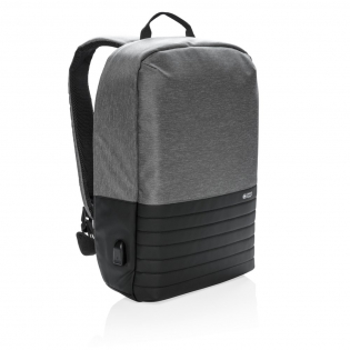 """This 15.6"""" laptop backpack with anti-theft back opening makes it easy to carry your tech gadgets and personal items around town. Inside padded laptop and tablet compartment. RFID safe sleeve for your wallet and passport. Connect your powerbank easily to the integrated USB charging port and charge your phone or tablet on the go. Hidden easy access back pocket."""