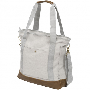 This on-trend zipped cotton canvas tote has an open main compartment with patterned lining and a front pocket with snap closure. Vinyl accent bottom and carry handles. Trolley strap-on back. Adjustable length shoulder strap. Part of the Field & Co.® Harper cotton canvas collection.