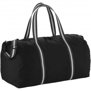 Diese ikonische Baumwoll-Reisetasche ist perfekt geeignet für Ihr nächstes Abenteuer. Kontrastfarbige gewebte Streifen verleihen diesem Klassiker frisches Aussehen. Großes Hauptfach mit Reißverschluss für Ihre Kleidung, verstellbarer, gestreifter Schultergurt aus Baumwolle.