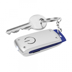 Keyring with a bright white LED light. With a striking colour accent. Batteries incl.