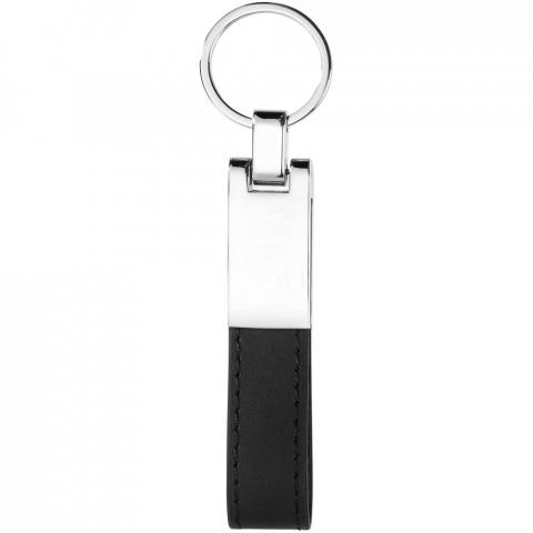Porte-clés avec bande imitation cuir et plaque métal. Sous boite noire.